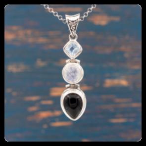 Сребърен медальон с топаз, лунен камък и оникс